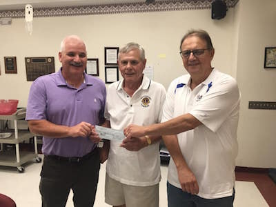 photo of check presentation by Mount Pleasant Lion's Club donation
